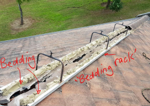 Bedding and pointing at tile roof hip