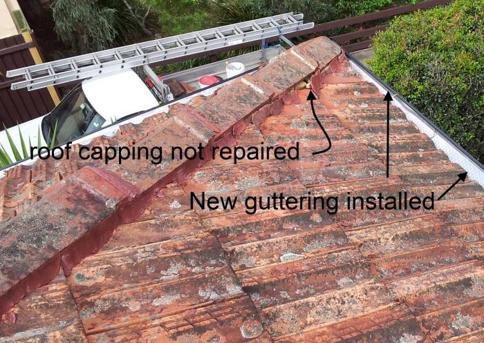 Guttering at corner of tile roof