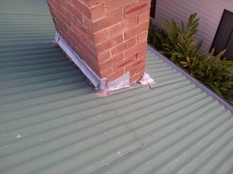 roof repairs at a chimney