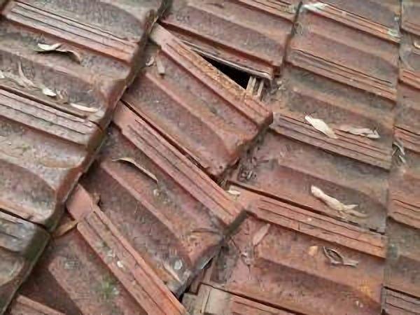 rusty nail breaking terracotta roof tile